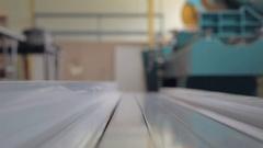 Man takes aluminium profile Stock Footage
