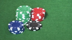 Set of casino chips on green table Stock Footage