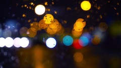 Wet the window with the background of the night city traffic view Stock Footage