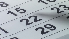 Marking the date on paper calendar Stock Footage