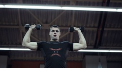 Muscle man doing exercises with bars Stock Footage