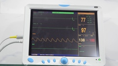 Patient monitor displays vital signs of EKG, SPO2 respiration and blood pressure Stock Footage