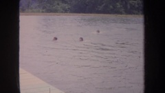 1968: youngsters enjoying a swim in a lake on a hot day MICHIGAN Stock Footage