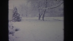 1968: classic house in a silent winter day, surrounded in heavy snow MICHIGAN Stock Footage