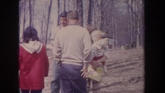 1968: many people strolling in a picnic area on the edge of a lake MICHIGAN Stock Footage