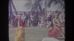 1969: pretty ladies wag their hips as they dance in colorful grass skirts. Stock Footage