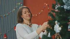 Mother and dauhgter decorate the Christmas tree, New Year Stock Footage