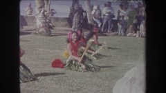 1969: hawaiian dancers performing with sticks on a beach for an audience HAWAII Stock Footage
