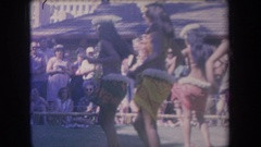 1969: women hula dancing in a circle in front of a crowd HAWAII Stock Footage