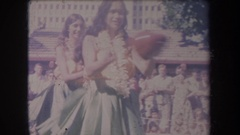 1969: people hula dancing and playing a drum HAWAII Stock Footage