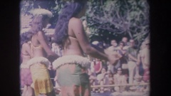 1969: hula dancers performing before a crowd of onlookers HAWAII Stock Footage