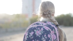 Girl goes with scool bag backview Stock Footage
