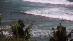 Surf School. Beginners (newbies) training in the ocean. Tourists surfing in Stock Footage
