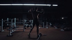 Muscular bodybuilder showing off his physique Stock Footage