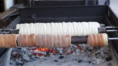 Trdelnik  Sweet Pastry being made at a christmas market in Prague Stock Footage
