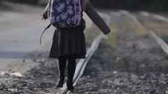 Girl walks on rails Stock Footage