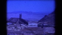 1958: panorama of a dozen homes in a desert with mountains in the distance Stock Footage