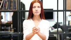 Woman praying  for Forgiveness, Indoor Stock Footage