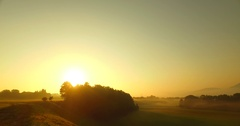 Intensive bold colors of sunset over foggy forests and pastures Stock Footage