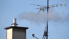 White smoke coming out of roof chimney on a cold and frosty morning Stock Footage