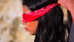 Blindfolded young glamorous sexy beautiful brunette. Man blindfolding submissive Stock Footage