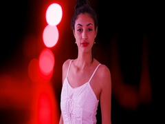 A Latin woman poses for a portrait in a sun dress while on a red background Stock Footage