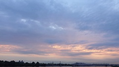 Evening sky over river, time lapse, sunset light shine through gap in cloudscape Stock Footage