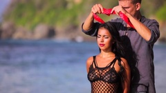 Young glamorous sexy beautiful brunette with shibari. Man blindfolding Stock Footage