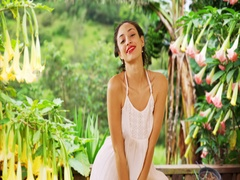 A Hispanic woman flirts with the camera in a tropical location Stock Footage