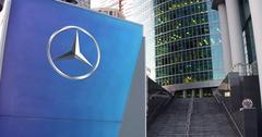 Street signage board with Mercedes-Benz logo. Modern office center skyscraper Stock Illustration