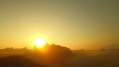 Strong, bold colors of sunset on a foggy morning Stock Footage