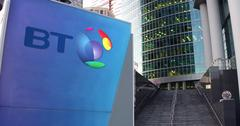 Street signage board with BT Group logo. Modern office center skyscraper and Stock Illustration