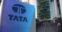 Street signage board with Tata Group logo. Modern office center skyscraper and Stock Illustration