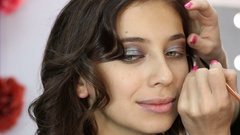 Makeup artist applying eyeshadow Stock Footage