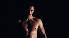 Fit muscular man drinking water or energy drink Stock Footage