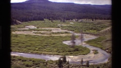 1980: a road with many curves near the forest and mountains. WESTERN USA Stock Footage