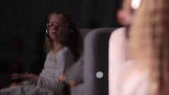 Cute little girl in headphones enjoying music Stock Footage