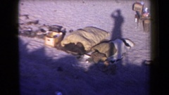 1958: shadow of someone can be seen recording the scene of a junkyard ARIZONA Stock Footage