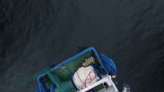 Flying over a Commercial Ship Fishing with Trawl Net at the Sea. Stock Footage