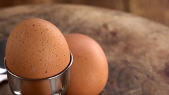 Boiled Eggs on a rotating wooden plate (seamless loopable; 4K) Stock Footage