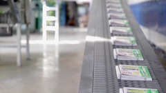 Conveyor belt in a printing house. Stock Footage