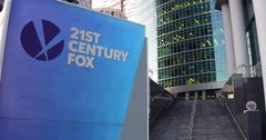 Street signage board with 21st Century Fox logo. Modern office center skyscraper Stock Illustration