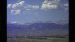 1980: panorama of a countryside with a few homes, barns and plowed fields Stock Footage