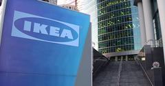 Street signage board with Ikea logo. Modern office center skyscraper and stairs Stock Illustration