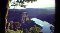 1980: lake surrounded by mountains and natural beauty is undisturbed on a sunny Stock Footage