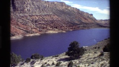 1980: a wide river flowing slowly surrounded by arid plateaus WESTERN USA Stock Footage
