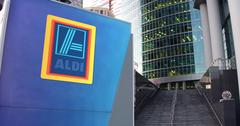 Street signage board with Aldi logo. Modern office center skyscraper and stairs Stock Illustration