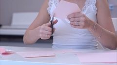 Young woman cutting out paper butterfly Stock Footage
