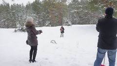 Family playing by throwing snowballs in the winter 96fps Stock Footage