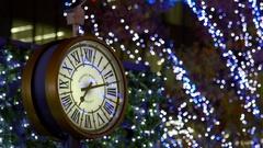 Clock over illuminated city Stock Footage